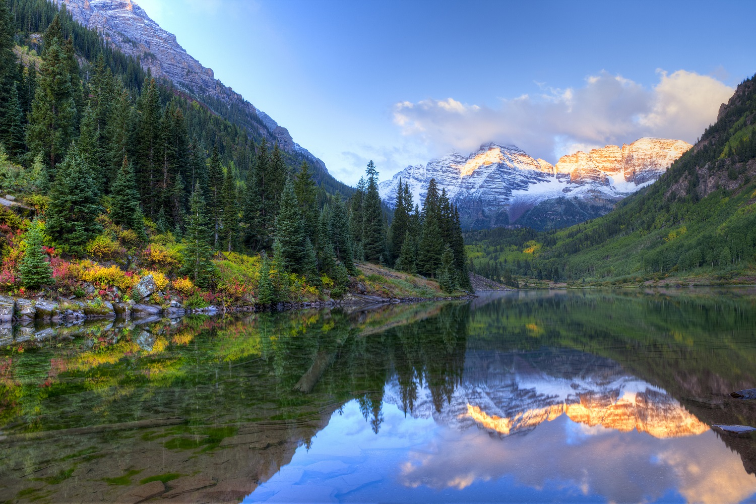 Reflection of Snowcapped Maroon Bells in fall, at sunrise.