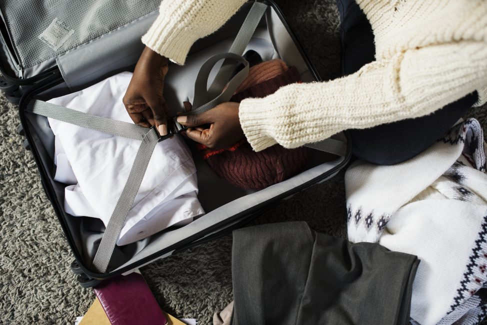 Woman packing following the Aspen Packing List